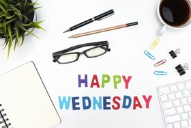 Office desk table with happy Wednesday! A cup of coffee. Glasses. Notebook. Paper clip. Office supplies. Free Download 2021 greeting card