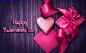Happy Valentine's day! It's a gift, right from the heart. A violet wooden background. A Purple Wooden Background. Free Download 2018 greeting card